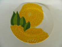 Primavera -lautanen keltainen