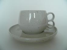 Halla teekuppi ja aluslautanen