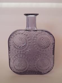 Grapponia -pullo neodyymi